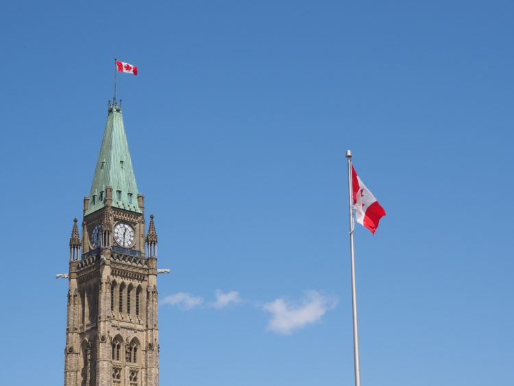 Ottawa parliament and Canadian flag